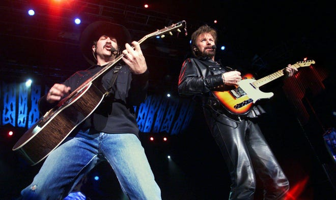 """Kix Brooks, left, and Ronnie Dunn of Brooks & Dunn take their """"Neon Circus and Wild West Show"""" at AmSouth Amphitheater during the Nashville stop of the tour April 29, 2001."""