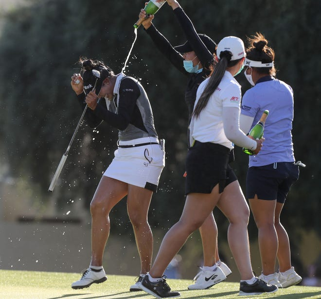 Patty Tavatanakit, left, is sprayed with champagne by her friends after winning the ANA Inspiration at Mission Hills Country Club in Rancho Mirage, April 4, 2021.