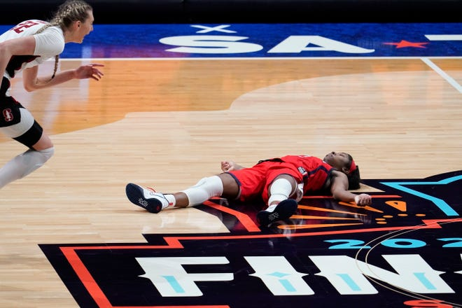 Arizona guard Aari McDonald lies on the court after missing a shot at the end of the championship game against Stanford in the women's Final Four NCAA college basketball tournament, Sunday, April 4, 2021, at the Alamodome in San Antonio. Stanford won 54-53. (AP Photo/Eric Gay)