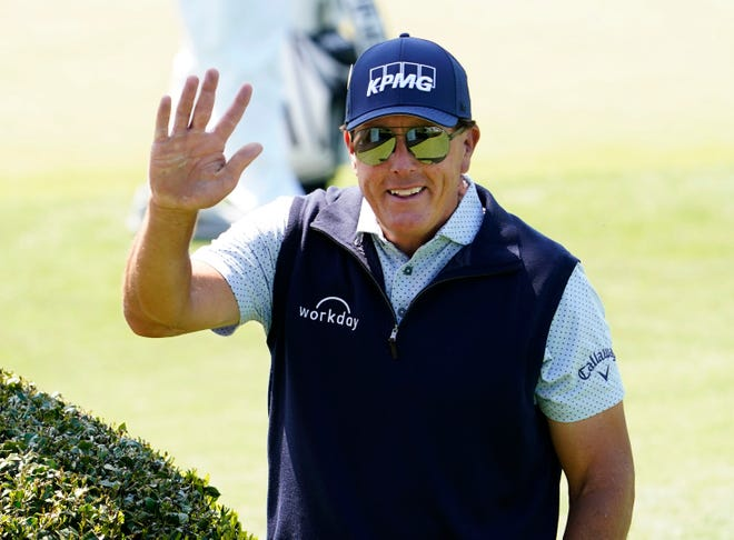 Apr 5, 2021; Augusta, Georgia, USA; Phil Mickelson waves to the patrons at the practice facility as he heads to the course for a practice round for The Masters golf tournament at Augusta National Golf Club. Mandatory Credit: Rob Schumacher-USA TODAY Sports