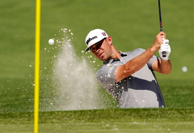 Apr 5, 2021; Augusta, Georgia, USA; Gary Woodland blasts out of a bunker at the practice facility as he prepares for The Masters golf tournament at Augusta National Golf Club. Mandatory Credit: Rob Schumacher-USA TODAY Sports