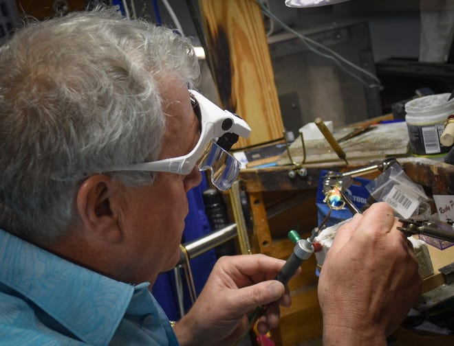Val Fawley welds a custom designed ring in his workshop inside Tru Luv Jewelers in Port Clinton.