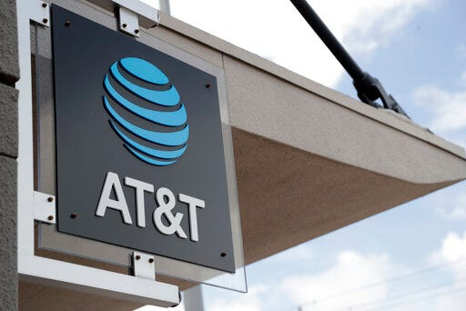 FILE - In this July 18, 2019, file photo, a sign is displayed at an AT&T retail store in Miami. Corporations have given more than $50 million in recent years to state lawmakers who have seized on Donald Trump's lies about a stolen 2020 election to push for new restrictions on the right to vote. That's according to a new report by the government watchdog nonprofit Public Citizen. Telecom-giant AT&T was the most prolific giver, donating over $800,000 since 2015 to authors of proposed restrictions, co-sponsors of such measures, or those who voted in favor of the bills, a new report by the Washington-based non-profit Public Citizen found. (AP Photo/Lynne Sladky, File)