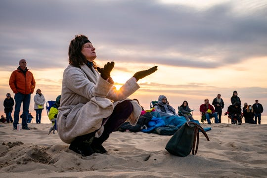 Parishioners gather on a beach for an Easter Sunday sunrise service hosted by Hope Community Church, Manasquan on Sunday, April 4, 2021 in Manasquan, New Jersey. (AP Photo / John Minchillo)