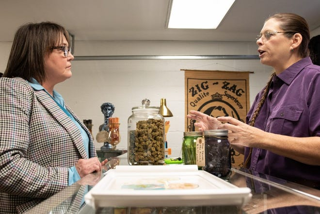 Traci Wolfe, right, owner of Classen Apothecare in Oklahoma City, Oklahoma talks to customer Mary McAninch about which strains are better suited to treat anxiety. McAninch uses medical marijuana to treat chronic pain from a nerve condition, arthritis and anxiety.