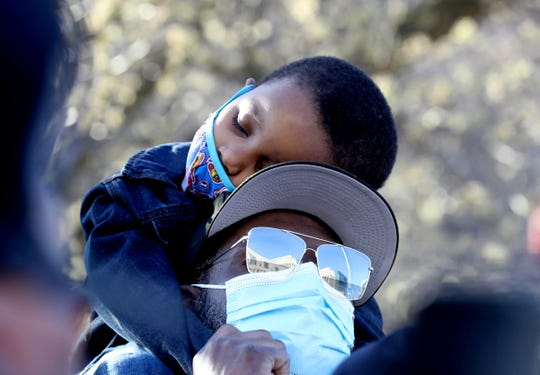 Exodus Simmons, 4, son of Earl Simmons, the rapper known as DMX, sleeps during a prayer vigil for Simmons outside White Plains Hospital, in White Plains, NY, April 5, 2021. DMX was taken to White Plains Hospital, where he remains on the maintenance of life.  He was taken to hospital after suffering a heart attack over the weekend.