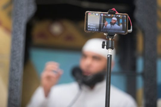 Imam Hadi Shehata is seen on a Facebook Live broadcast giving a sermon as he leads Friday prayers Friday, April 2, 2021, at Masjid Ibrahim mosque in Newark, Delaware.
