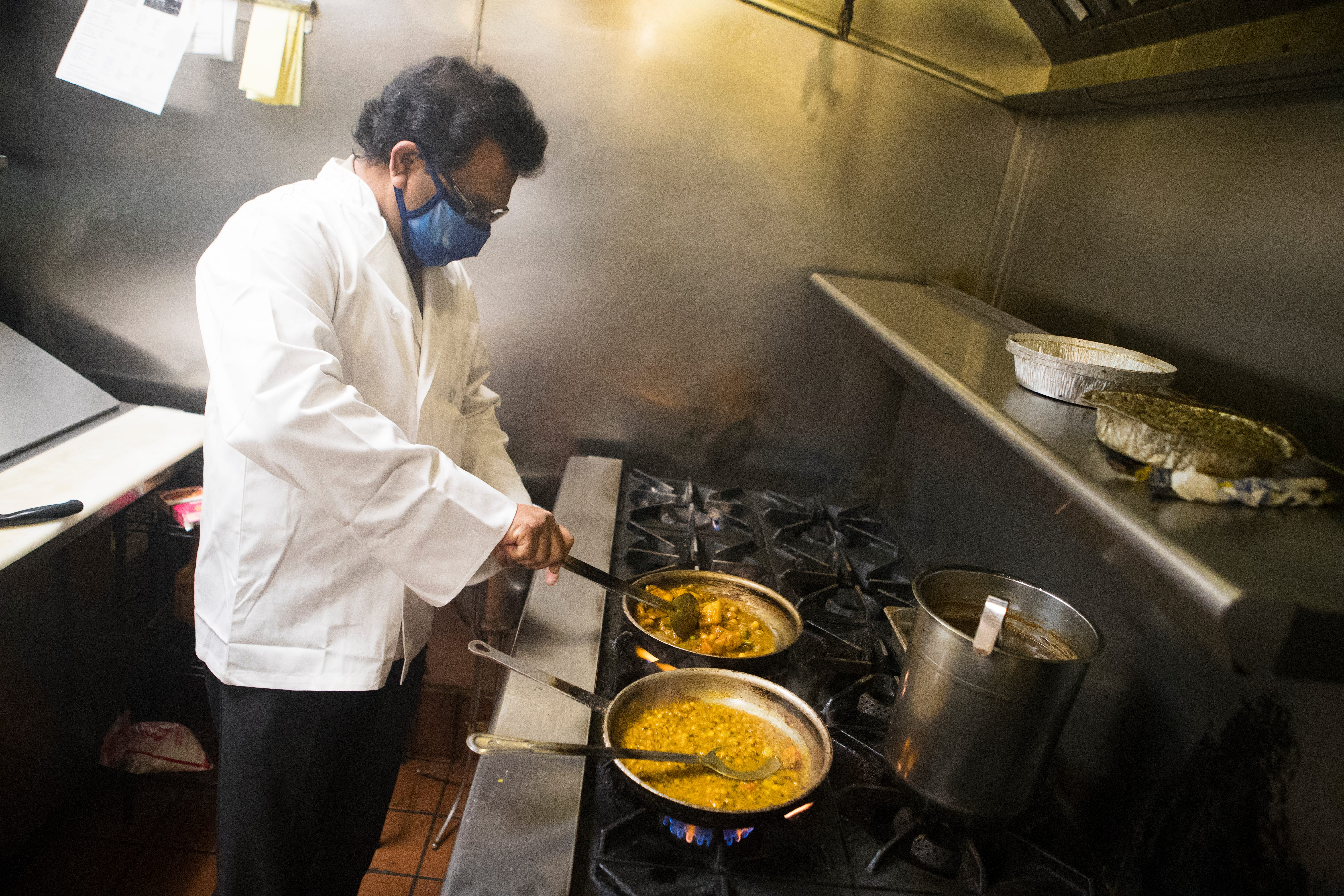 Indian Grille owner Mohammed Elias cooks lentil beans before the lunch crowd arrives to eat Thursday, April 1, 2021.