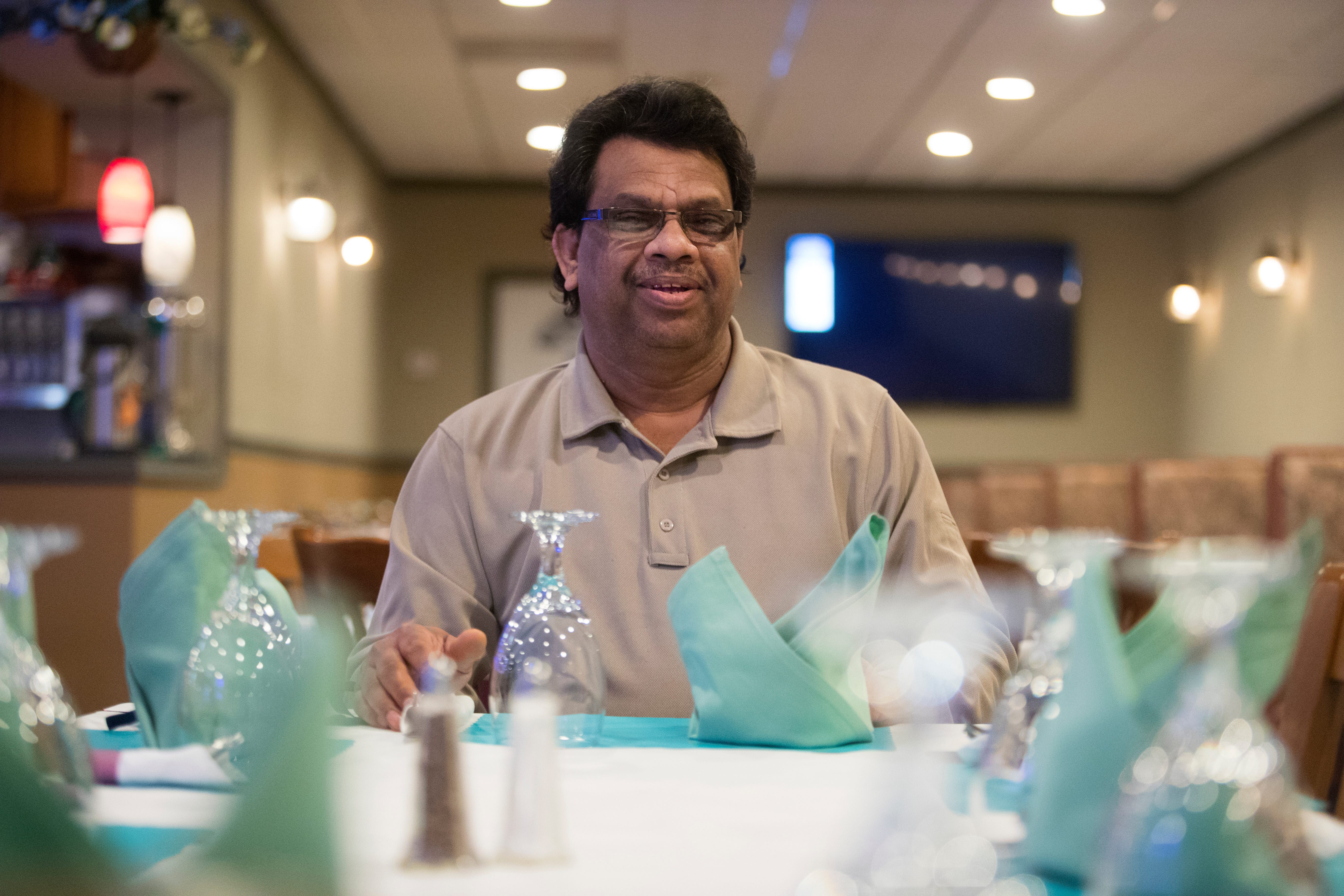 Indian Grille owner Mohammed Elias sits for a portrait at his restaurant Thursday, April 1, 2021.