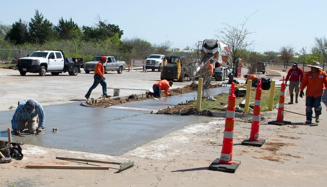 While Wichita Falls leaders turn their attention to road improvement and other work in the city's Business Park, good weather allowed work to continue Monday on the Maplewood Extension Project that will eventually join Maplewood Avenue into McNiel Avenue. Construction is due to be finished later this year.