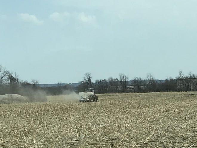 A farmer spreads fertilizer on a field near Fond du Lac County on April 5, 2021.