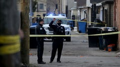 Police work at the scene of a fatal shooting of a 13-year-old boy by a police officer on March 29 in Chicago.
