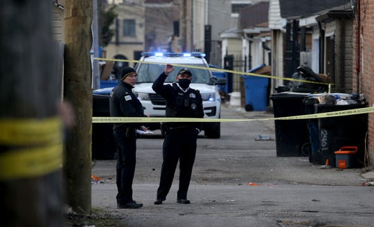 Police are working on the scene of a fatal shooting of a 13-year-old boy by a Chicago police officer on Monday, March 29, 2021 in Chicago.