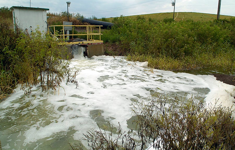 A discharge of saltwater from an gypsum stack flows into a drainage ditch in Northern Manatee County, Fla., after a liner was fractured in 2011.
