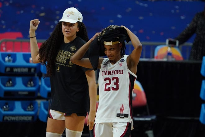 Stanford guard Kiana Williams (23) and Haley Jones celebrated after winning the national championship Sunday.
