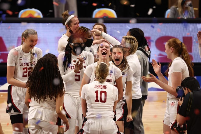 Stanford players celebrate after winning the Cardinal's third women's college basketball championship - and first since 1992.