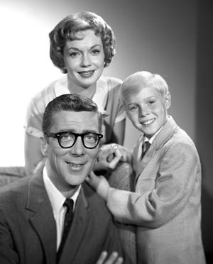 Dennis The Menace, a CBS television situation comedy. Pictured from left is Herbert Anderson (as Henry Mitchell), Gloria Henry (as Alice Mitchell), Jay North (as Dennis Mitchell). May 2, 1960.