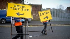 Workers at a drive in testing station at Walsall Arena and Arts Centre remove direction signs after the first day of COVID-19 testing to track down a South African coronavirus variant found in the area on February 2, 2021 in Walsall, United Kingdom. Health authorities have found more than 100 cases of a coronavirus variant first identified in South Africa, prompting a scramble to deploy new testing initiatives across eight areas in England. It is thought the variant is more contagious, but not more deadly, than the variant that has predominated in England throughout the COVID-19 pandemic.