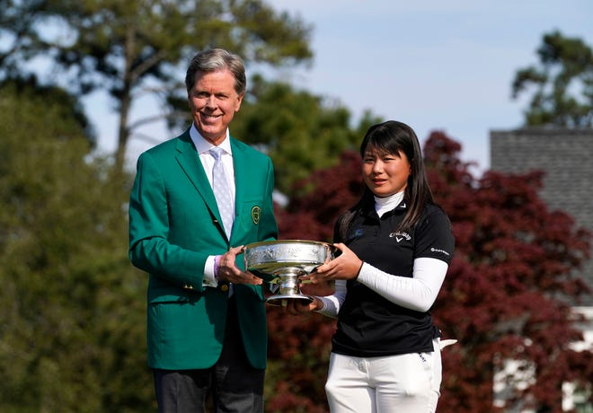 Fred Ridley, Chairman of Augusta National Golf Club and the Masters Tournament poses with champion Tsubasa Kajitani of Okayama, Japan, after the Augusta National Women's Amateur.