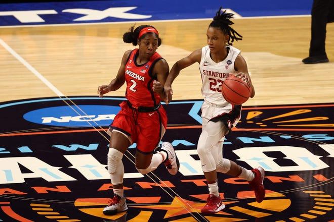 Kiana Williams dribbles past Aari McDonald during their NCAA Tournament title game.