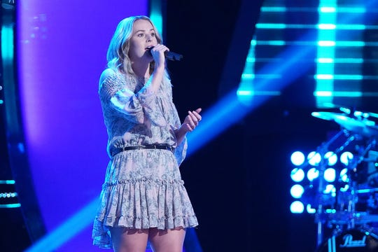 "Emma Caroline performs on ""The Voice."""