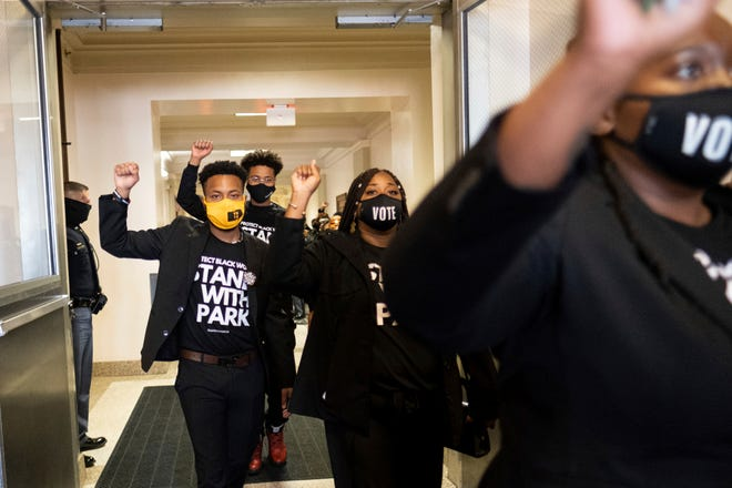 Supporters of Georgia state Rep. Park Cannon, D-Atlanta, leave the Capitol in Atlanta on March 29, 2021, after escorting her into the building. Cannon was arrested for knocking on the governor's office door as he signed voting legislation.
