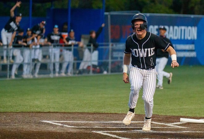 Bowie's Ben Merriman crosses the plate for the first run of the game in a win against Westlake April 1. The Bulldogs swept Westlake to remain tied with Lake Travis atop the District 26-6A standings entering this week.