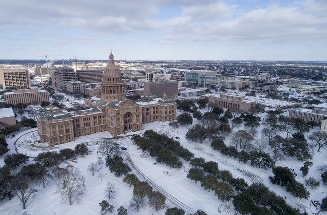 The Texas Capitol grounds are blanketed in snow in this Feb.15 photo. Weather disasters will continue to occur with increased frequency and magnitude due to climate change, State Rep. Gina Hinojosa writes. [JAY JANNER/AUSTIN AMERICAN-STATESMAN]