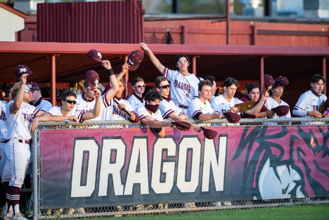 The Round Rock dugout enjoys a win over Westwood earlier this season. The Dragons moved into a first-place tie in District 25-6A with Vandegrift after sweeping Hutto last week.