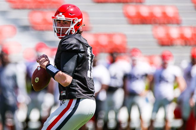 Georgia quarterback JT Daniels (18) during the Bulldogs' practice session on Dooley Field at Sanford Stadium in Athens, Ga., on Saturday, April 3, 2021. (Photo by Tony Walsh)