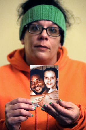Janeen Forepaugh show a photograph of her and her partner, Samuel T. White. White died by suicide on May 27.