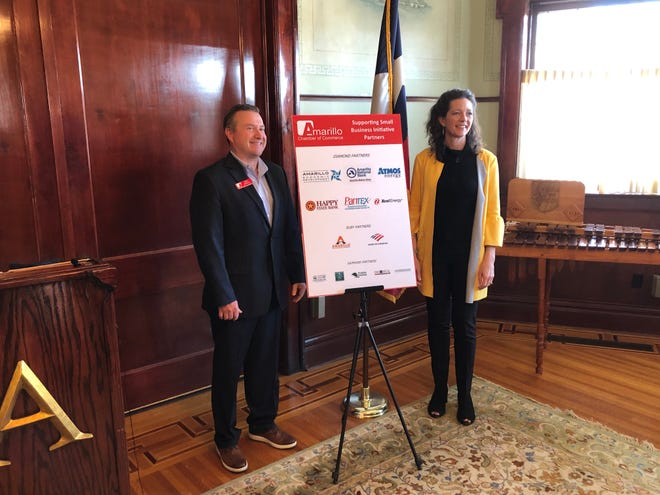 Harrison and Nelson pose for a picture after Tuesday's news conference, announcing the Amarillo Chamber of Commerce's Supporting Small Business initiative.