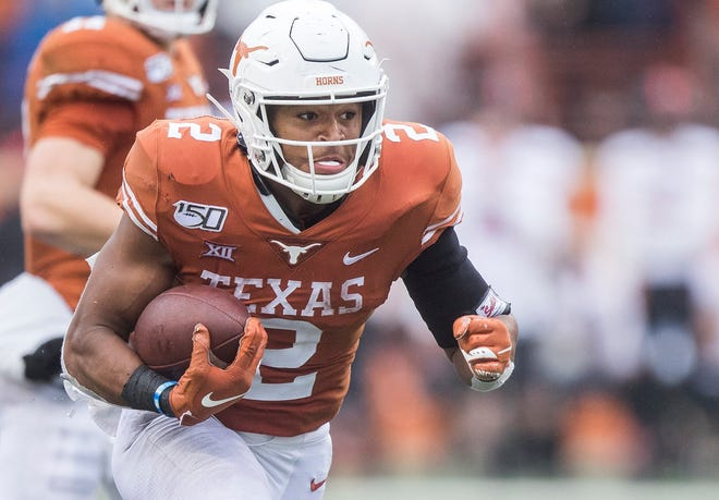 """Texas running back Roschon Johnson said new coach Steve Sarkisian's offensive playbook """"has been a bit of a load"""" to absorb. """"At the end of the day, the people who really care about it are the people who really want to make strides to get better and win championships,"""" he said."""