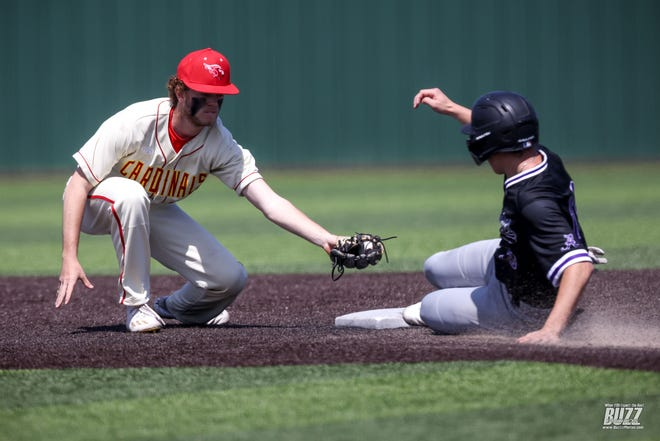 Melissa's Mason Perkins (22) reaches to tag Joey Slaughter (13) during a game against Anna High School on Friday, April 2, 2021 in Melissa. The Anna Coyotes won the game 11-3.