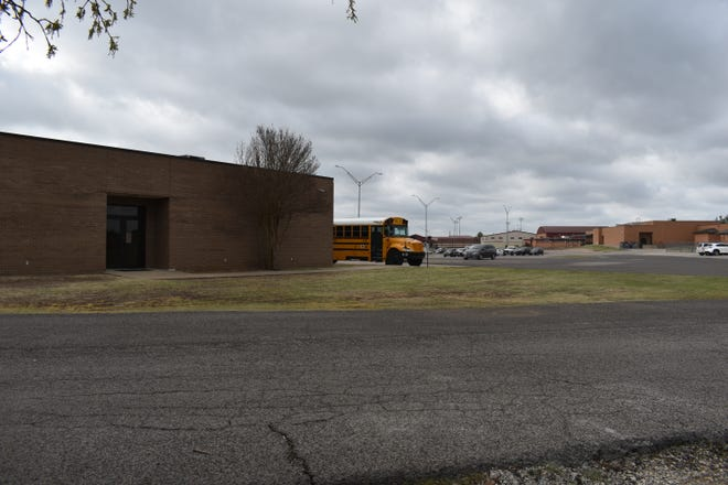 A school bus sits parked near the western side of Plainview Middle School Tuesday, April 6, 2021. If approved by voters, a $2.5 million safe room will be accessible from the doors shown.