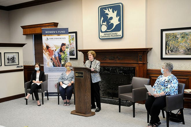 Dr. Joann Ford speaks at a news conference for the Ashland County Community Foundation's Women's Fund child care Initiative while Kristin Aspin, Brenda Uselton and Jane Roland listen on Tuesday, April 6.