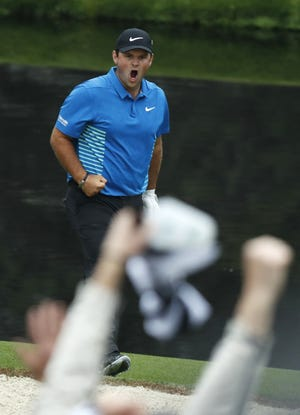 Patrick Reed celebrates his eagle on No. 15 during the third round of the 2018 Masters tournament.