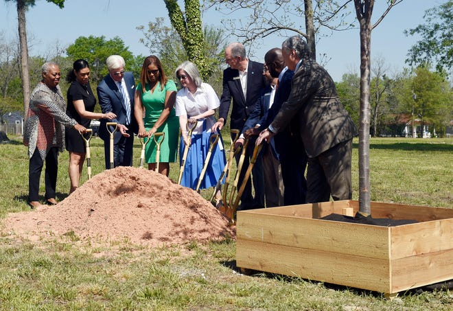 Community officials take part in a ceremonial groundbreaking for the HUB for Community Innovation on Tuesday, a project backed with a $10 million gift from Augusta National Golf Club and corporate partners.