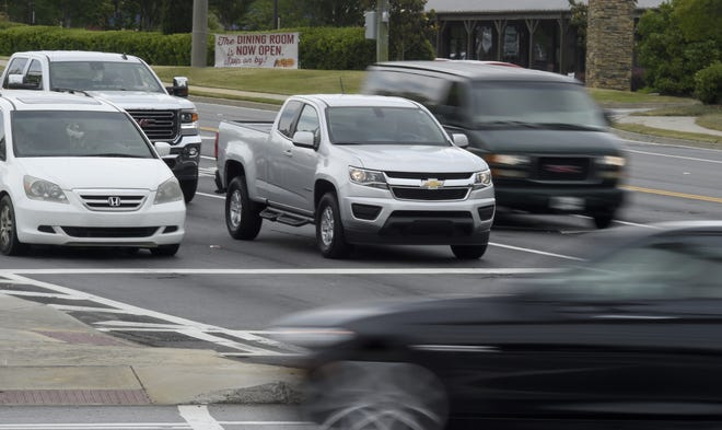 Motorists at the intersection of Washington and North Belair roads in Evans wait for the light to change, in this photo from 2020.