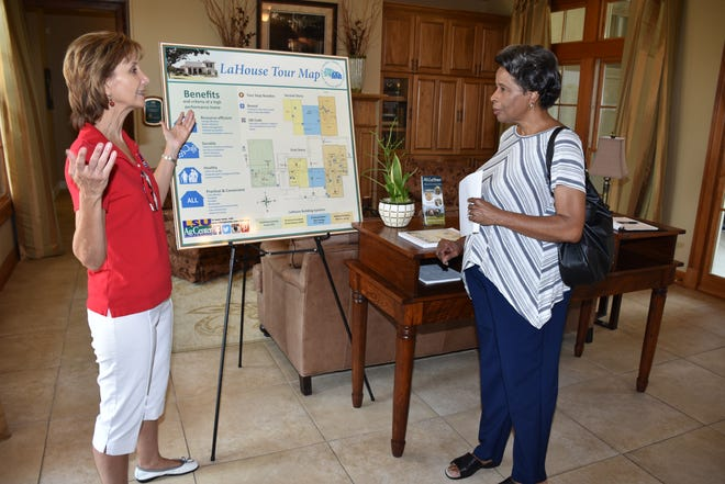LSU AgCenter housing specialist Claudette Reichel discusses the features of the LSU AgCenter LaHouse Home and Landscape Resource Center during an open house on July 23.