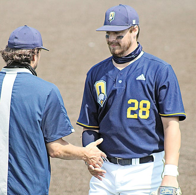 Oklahoma Wesleyan University's Ryan Kouba, right, receives congratulations as he comes off the field during a star-spangled weekend that saw him hit 4homers and drive in 8 runs in 3 games.