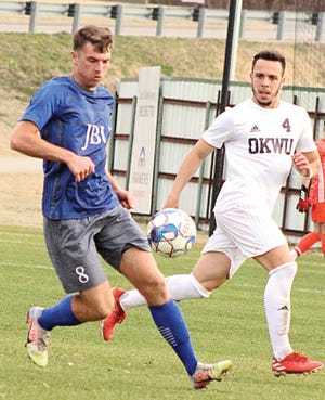 Oklahoma Wesleyan University's Stevic Ognjen, right, challenges an opposing player for the ball during men's soccer player earlier this season in Bartlesville.