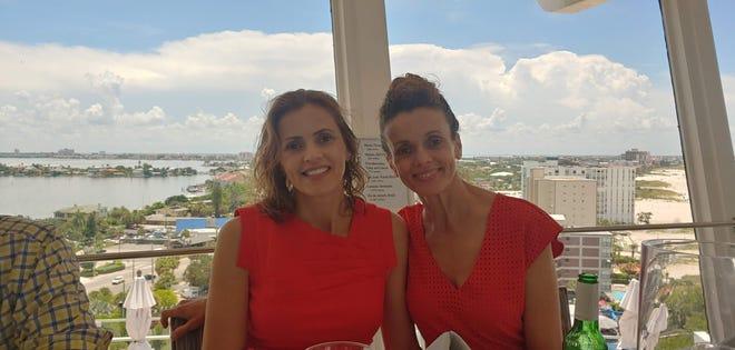 Pilot Adriana Barcelos de Oliveira, left, and her sister, Cape resident and essayist Rosiane Barcelos de Oliveira at Spinner's Rooftop Revolving Bistro in St. Petersburg, Fla. [Vanessa de Oliveira]