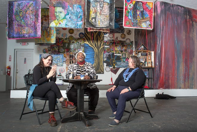 Artists Claire Bubeck, Richard Duarte Brown and Mindy Staley in the midst of the art exhibit at the Vanderelli Room.