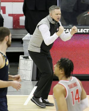 Ohio State Buckeyes head coach Chris Holtmann cheers on his team during Sunday's NCAA Division I Big Ten conference basketball game against the Michigan Wolverines at Value City Arena in Columbus, Ohio, on February 21, 2021.