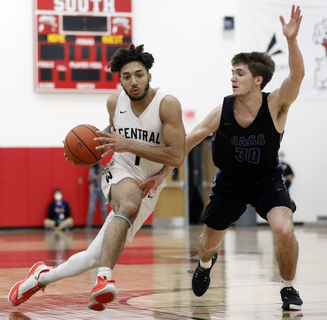 Westerville Central's Tasos Cook, here driving against Hilliard Bradley's AJ Mirgon, averaged 21.2 points per game as a senior.