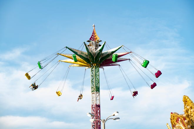 The giant swings spin around at the Lake County Fair in 2019. The fair is back today in Eustis for its 100th time.