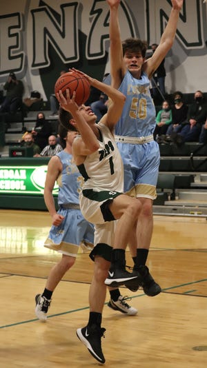 Shenandoah senior Christian Duniver (1) drives to the basket against a Frontier defender during action last season. Duniver was named to the Division IV All-Ohio First Team on Monday.