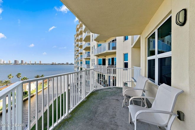 Its northeast-facing location of this exclusive South Daytona condominium home provides incredible water views from every window, slider and balcony.
