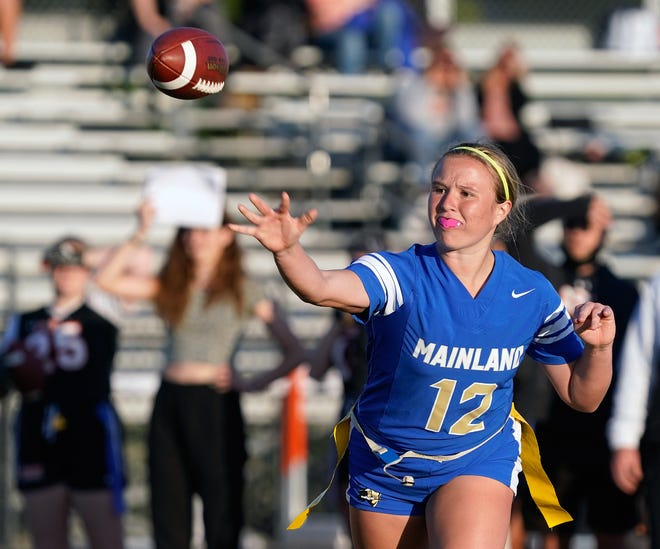 Junior Alexa Wilson has totaled 2,615 yards and 56 touchdowns, garnering all-state consideration in the process, as QB for the Mainland High flag football team.